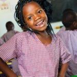 Eine Schülerin der Escolinha Julie Postel lächelt in Metarica, Mosambik. (Foto: Achim Pohl/SMMP)